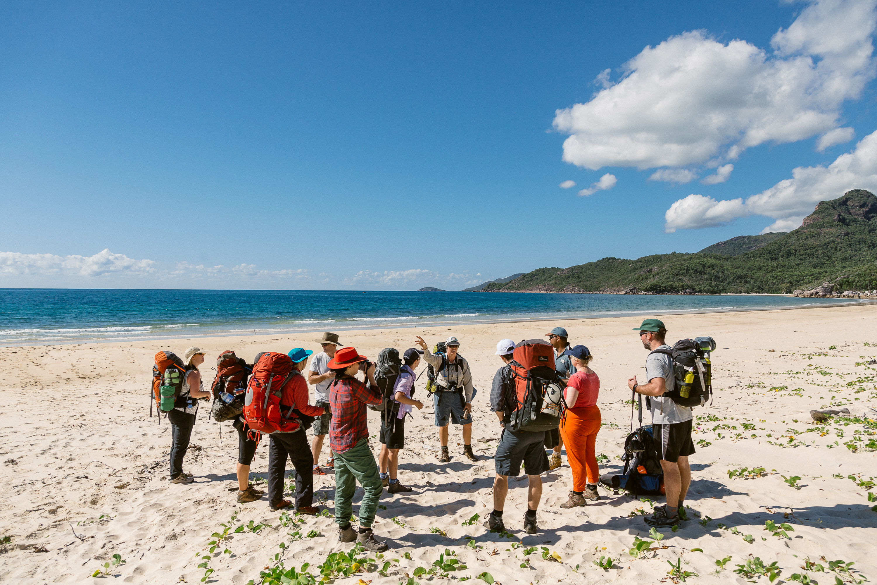 Queensland National Park ranger Emma Schmidt briefs a group of hikers ahead of a 4 day adventure along the Thorsborne Trail, a 40km hiking path that visits several of Hinchinbrook Island's beaches and waterfalls. Situated off the coast of North Queensland, Australia, Hinchinbrook Island is a mountainous National Park characterised by rainforest and golden beaches. Walkers typically take 4 days to complete the hike, and to protect the ecosystem of the island only 40 visitors are allowed onto the trail at any one time.